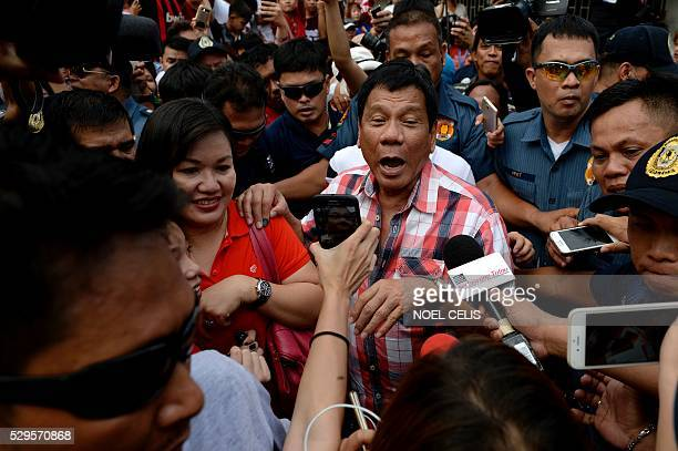 Presidential frontrunner and Davao City Mayor Rodrigo Duterte leaves the voting precint after casting his vote at Daniel Aguinaldo National High...
