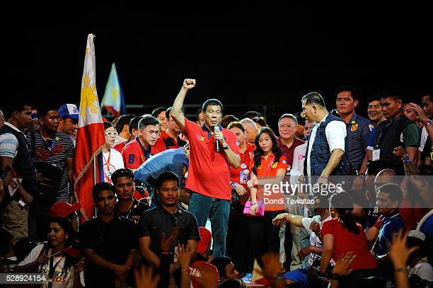 Presidential frontrunner Rodrigo Duterte gestures during his final campaign rally on May 7 2016 in Manila Philippines Duterte a toughtalking mayor of...