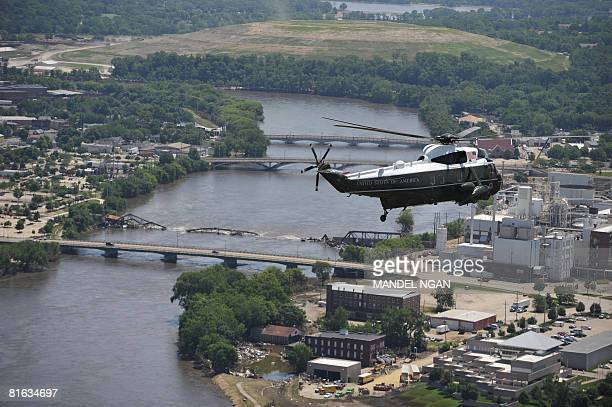 Presidential helicopter flies above a damaged bridge on June 19, 2008 in Cedar Rapids, Iowa. US President George W. Bush is in Iowa to survey flood...