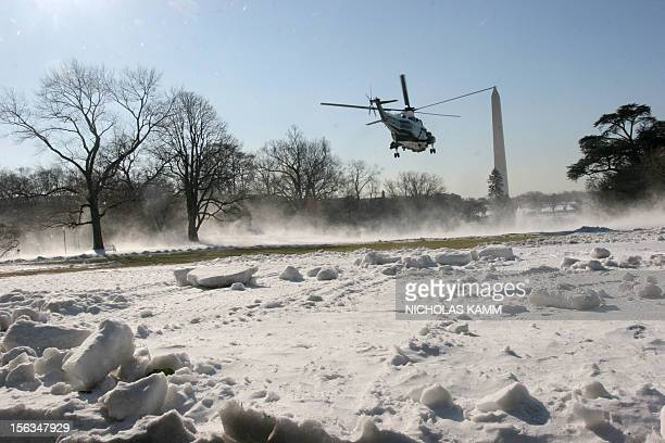 Presidential helicopter Marine One carrying US President George W. Bush blows up snow as it takes off from the South Lawn of the White House in...