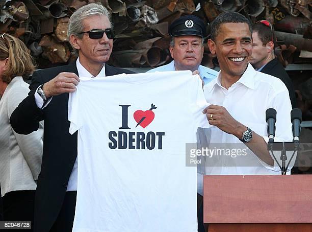 Presidential hopeful Barack Obama receives a t-shirt from Sderot Mayor Eli Moyal after press conference at Sderot Police station July 23, 2008...