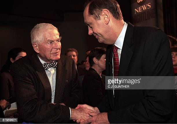 Presidential hopeful Bill Bradley talks with former Watergate Special Prosecutor Archibald Cox following Bradley's debate with Vice President Al Gore...