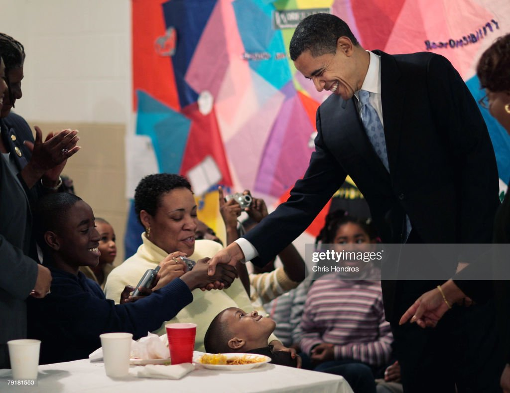 Presidential hopeful Sen. Barack Obama (D-IL) shakes hands with children at the St. James United Methodist Church January 23, 2008 in Darlington, South Carolina. Obama is keeping a furious schedule ahead of the South Carolina primary on January 26.