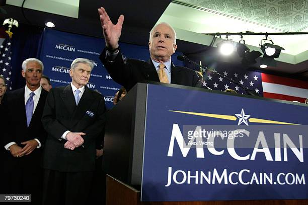 S presidential hopeful Sen John McCain speaks to supporters as US Sen John Warner and Florida Gov Charlie Crist look on during a primary night party...