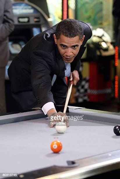 Presidential hopeful US Sen Barack Obama plays pool prior to MTV's Choose Or Lose taping at Whistle Pub on March 17 2008 in Scranton Pennsylvania