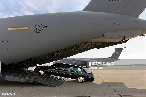 A Presidential limousine is loaded onto a C5 military transport plane bound for eastern Europe where President Bush is headed next week A secure...
