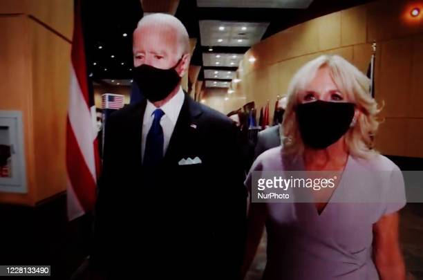 Presidential nominee and former US Vice President Joe Biden and wife Jill Biden wear face masks backstage during the closing moments of the virtual...