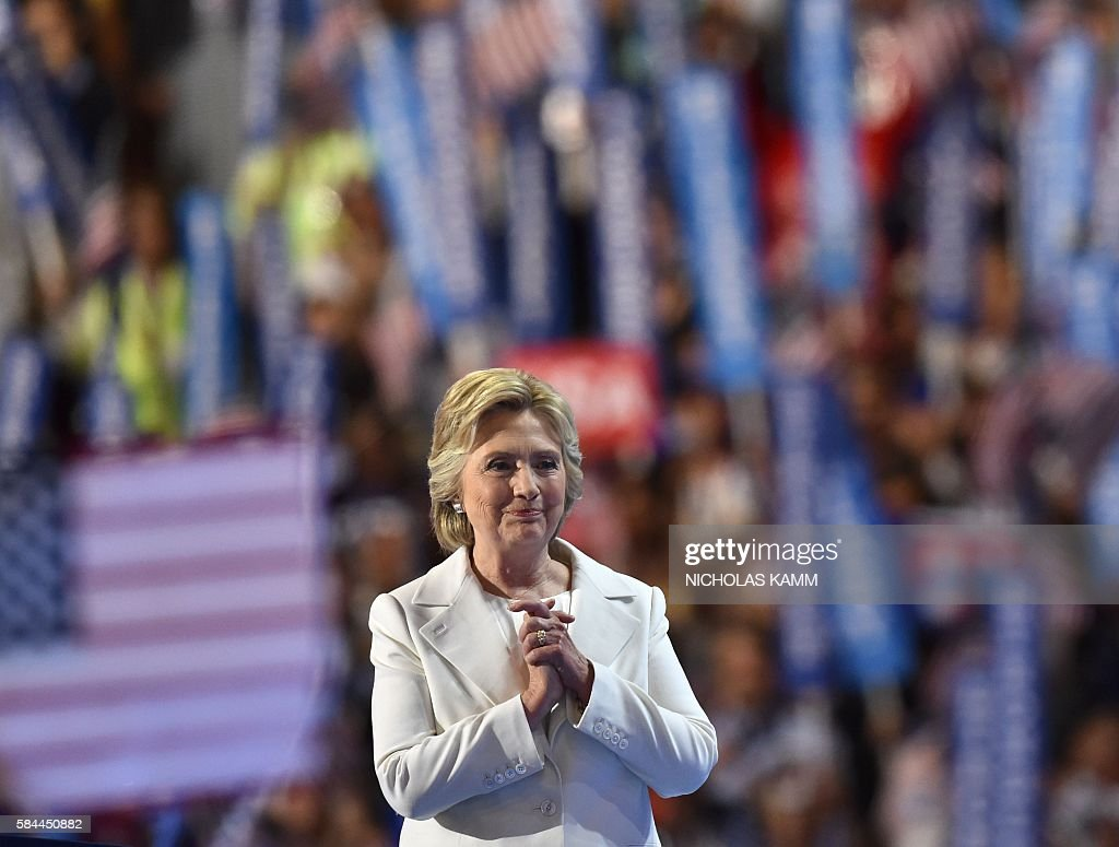 Presidential nominee Hillary Clinton gestures after the fourth and final day of the Democratic National Convention on July 28, 2016 in Philadelphia, Pennsylvania. / AFP / Nicholas Kamm