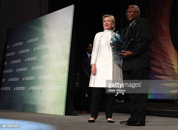 Presidential nominee Hillary Clinton is presented with the Trailblazer Award from Rep James Clyburn during the Congressional Black Caucus Annual...