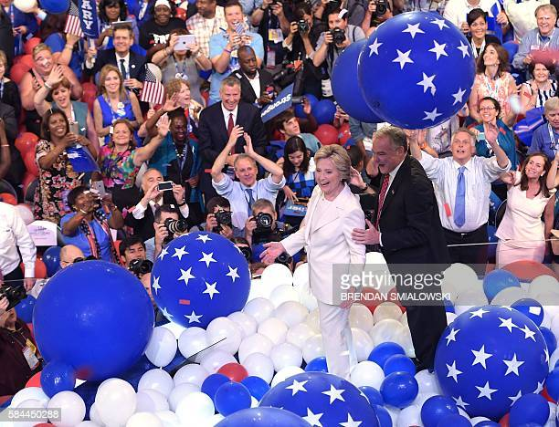 Presidential nominee Hillary Clinton walks with Vice Presidential candidate Tim Kaine through ballons after the fourth and final day of the...