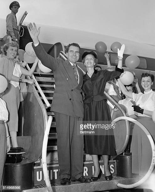 Presidential nominee Richard Nixon and Mrs. Nixon are shown as they prepared to board an airliner at National Airport bound for Mrs. Nixon's...