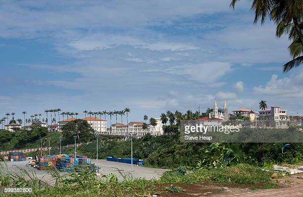 presidential palace and old spanish cathedral with containers in foreground in skyline of the capital city of malabo, equatorial guinea, africa - malabo fotografías e imágenes de stock