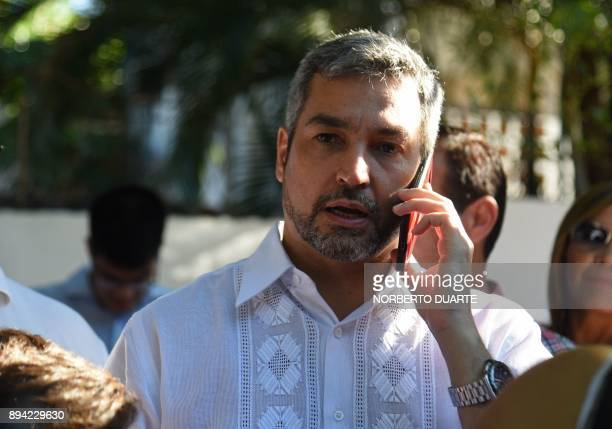 Presidential precandidate Mario Abdo Benitez speaks on nis mobile phone after casting his vote during Paraguay's rightwing Colorado party primary...