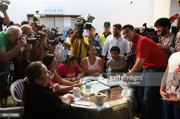 Presidential precandidate Santiago Pena casts his vote during Paraguay's rightwing Colorado party primary elections in Asuncion Paraguay on December...