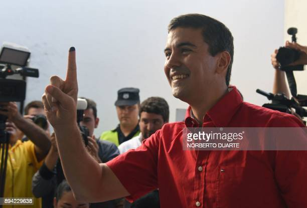 Presidential precandidate Santiago Pena smiles after casting his vote during Paraguay's rightwing Colorado party primary elections in Asuncion...