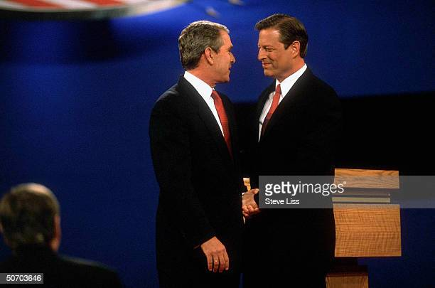 Presidential rivals Governor George W Bush and Vice President Al Gore shaking hands in their first campaign debate