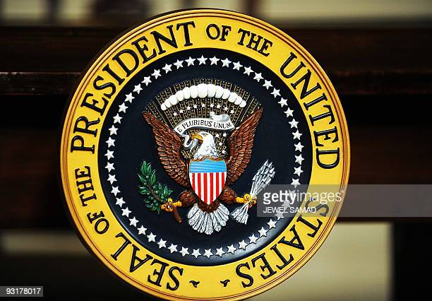 Presidential seal is pictured before US President Barack Obama signs the Ryan White HIV/AIDS Treatment Extension Act of 2009 in the Diplomatic...