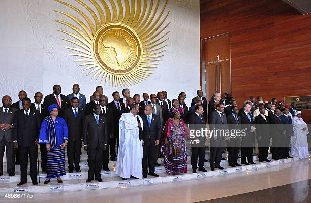 Presidents and Heads of governments pose for a group photo during the opening session of the African Union on January 30 2014 at the AU headquarters...