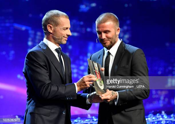 Presidents Award Recipient David Beckham receives the award from UEFA President Aleksander Ceferin during the Champions League Group Stage draw part...