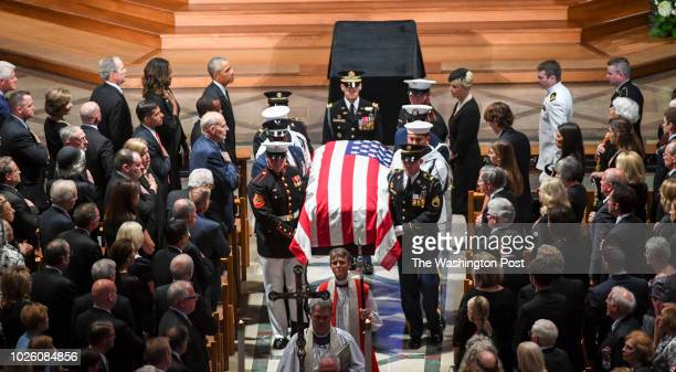 Presidents Bill Clinton George Bush and Barack Obama look on with the family as the casket is taken out following the funeral service at the National...