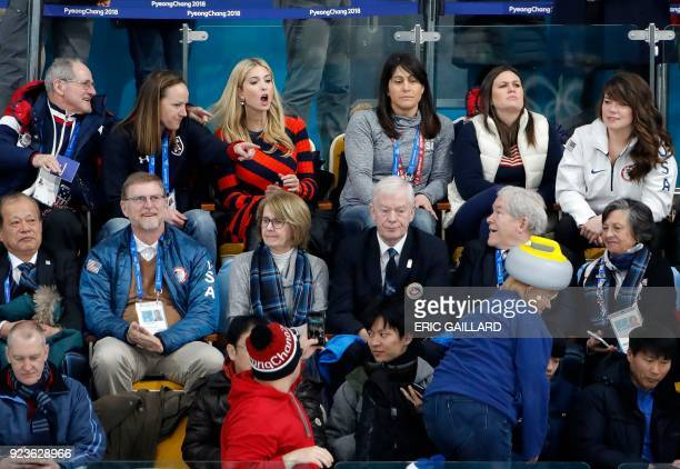 President's daughter and senior White House adviser Ivanka Trump reacts as a spectator wearing a hat in the shape of a stone moves in the stands...