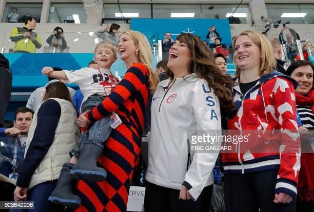 US President's daughter and senior White House adviser Ivanka Trump holds Luke Shuster son of skip John Shuster of the US next to athletes Cory...