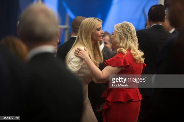 US President's daughter Ivanka Trump kisses Israel Prime Minister wife Sara Netanyahu during the opening of the US embassy in Jerusalem on May 14...