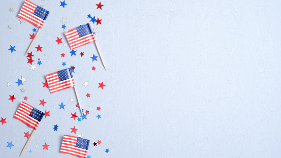 Presidents Day USA, Independence Day, US election concept. American flags and confetti stars on blue background. Flat lay, top view. 1197557854