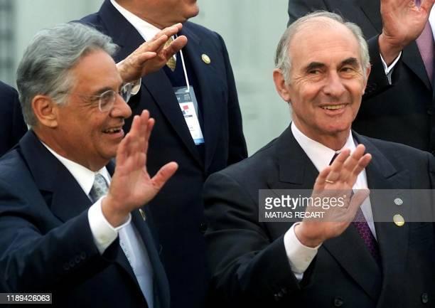 Presidents Fernando Henrique Cardoso of Brazil and Fernando De La Rua of Argentina wave while posing for the official photo of the XV-th Presidential...