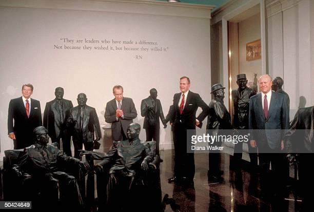 Presidents Ford Bush Nixon Reagan amid statues of Churchill de Gaulle Adenauer Sadat Khrushchev Shigeru Mao Zhou Brezhnev Meir at Nixon Library