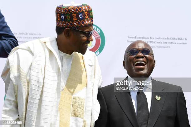 Presidents Muhammadu Buhari of Nigeria and Nana AkufoAddo of Ghana pose after the opening ceremony of ECOWAS G5 security summit in Ouagadougou on...