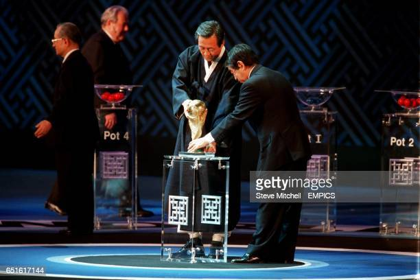 President's of the Korean and Japanese FA place the FIFA World Cup on its stand in preparation for the World Cup 2002