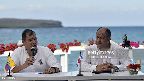 Presidents Rafael Correa of Ecuador and Luis Guillermo Solis of Costa Rica talk to the press after signing an agreement that finally delineates the...