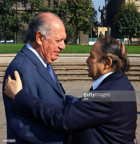 Presidents Ricardo Lagos from Chile and Abdelaziz Bouteflika from Algeria shake hands before a meeting at La Moneda Palace in Santiago 16 May 2005...