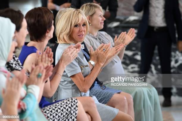 President's wife Brigitte Macron applauds next to Estonian Prime Minister's wife Karin Ratas Belgian Prime Minister's partner Amelie Derbaudrenghien...