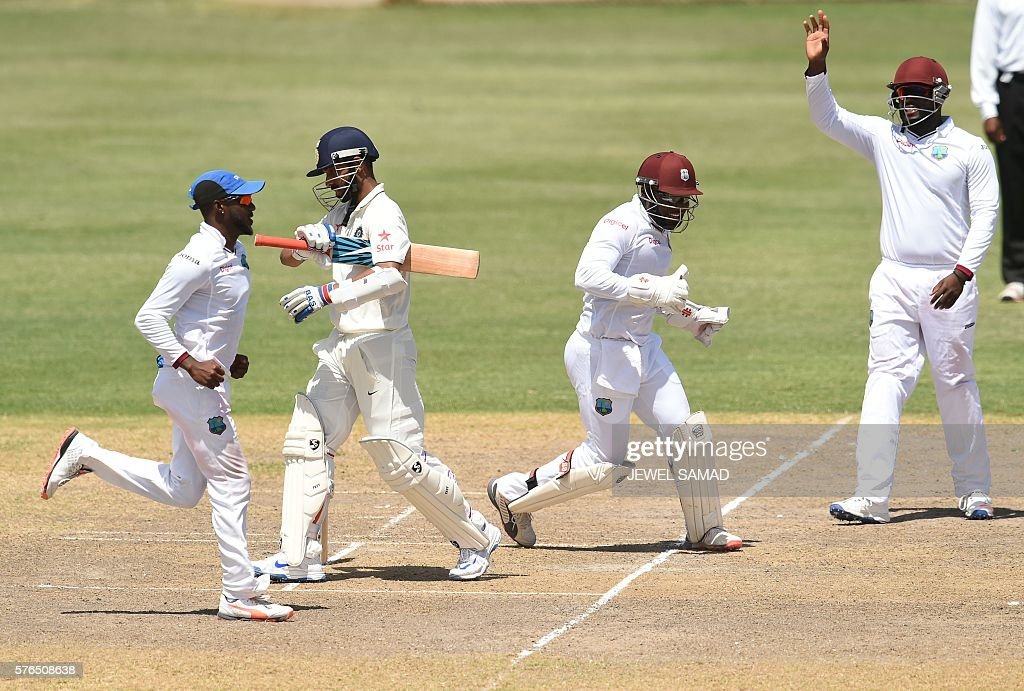 President's XI squad cricketers celebrate dismissing Indian cricketer Ajinkya Rahane (2nd-L) during Day 2 of the three-day tour match between India and WICB President's XI squad at the Warner Park stadium in Basseterre, Saint Kitts, on July 15, 2016. / AFP / Jewel SAMAD