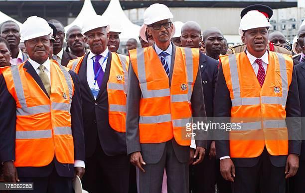 Presidents Yoweri Museveni of Uganda Paul Kagame of Rwanda and Uhuru Kenyatta of Kenya observe as the first container is offloaded onto Berth No 19...