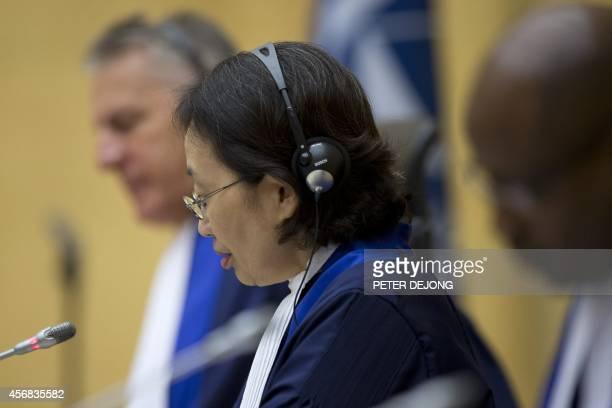 Presiding judge Kuniko Ozaki of Japan opens the court's status hearing where Kenya's president Uhuru Kenyatta appeared before the International...