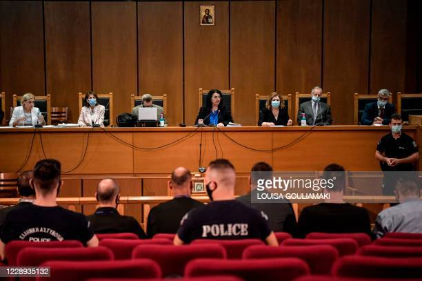 Presiding judge Maria Lepenioti sits in the supreme court as she announces the verdict in the trial of suspected members of neo-Nazi party Golden...