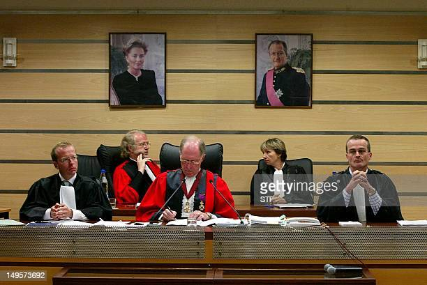 Presiding judge Stephane Goux flanked by his assistants writes 17 June 2004 during the reading of the verdict at the Arlon courthouse Belgian...