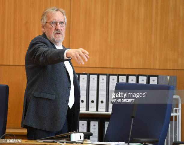 Presiding judge Thomas Sagebiel arrives for the start of the trial of an Iraqi man identified only as Taha alJ believed to have belonged to the...