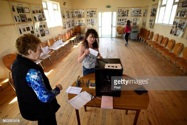 Presiding Officer Carmel McBride looks on as a voter casts their vote in the polling box for the referendum on liberalising abortion law a day early...