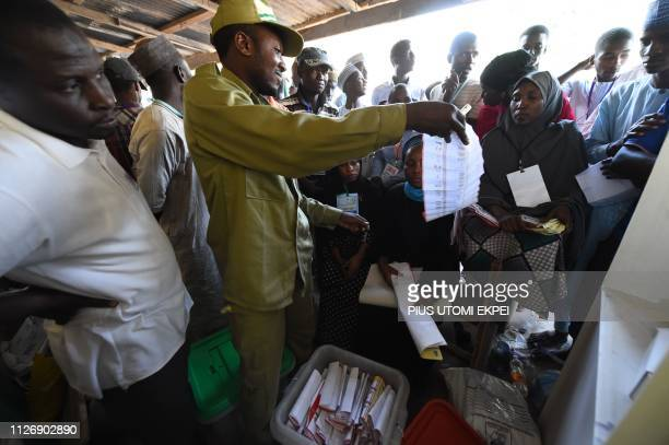 A presiding officer count ballots after voting ended at a polling station in Kano in the commercial capital of northern Nigeria on February 23 2019...