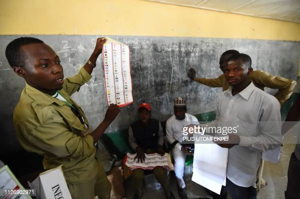 Presiding officer count ballots after voting ended at a polling station in Kano, in the commercial capital of northern Nigeria, on February 23, 2019....