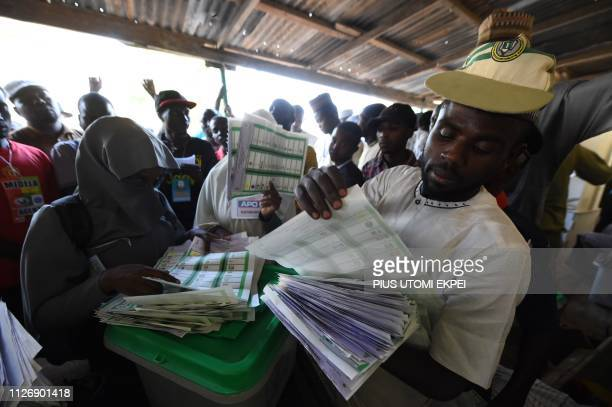 Presiding officer counts ballots after voting ended at a polling station in Kano, the commercial capital of northern Nigeria, on February 23, 2019. -...