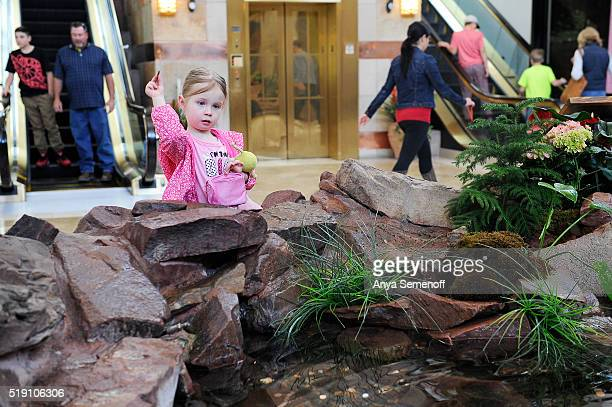Presley Corson throws coins into the fountain at Park Meadows Mall on March 24 in Lone Tree Colorado Park Meadows Mall is celebrating its 20th...