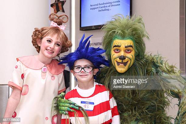 Presley Ryan Justin Neglia and The Grinch pose for photos at Madison Square Garden on October 23 2014 in New York City