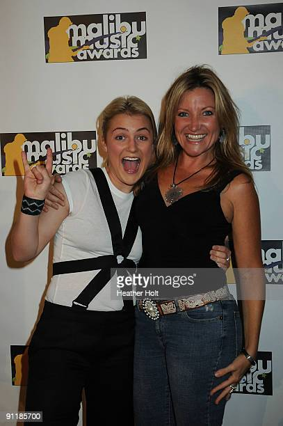Presley Tucker and Sheri Pedigo pose on the red carpet at the 2nd Annual Malibu Music Awards on September 26 2009 in Malibu California