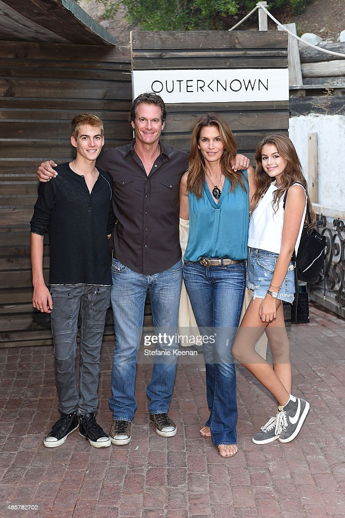 Presley Walker Gerber, Rande Gerber, Cindy Crawford and Kaia Jordan Gerber attend Kelly Slater, John Moore and Friends Celebrate the Launch of Outerknown at Private Residence on August 29, 2015 in Malibu, California.