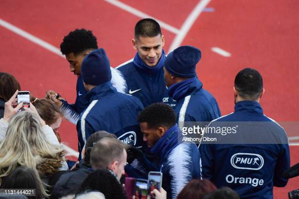 Presnel Kimpembe and Alphonse Areola with fans during the France training session at Centre National du Football on March 18 2019 in...